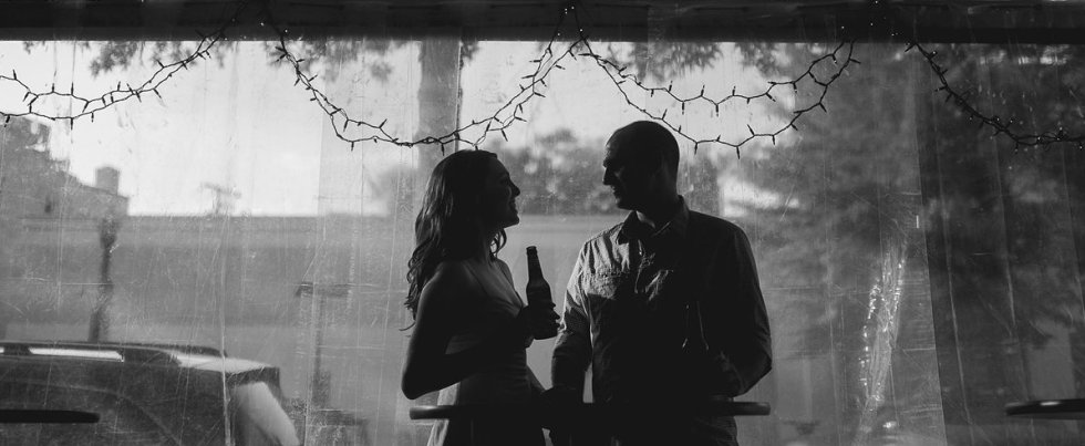 006-couple-drinking-beer-dc-arligton-clarendon-black-and-white-engagement-photo